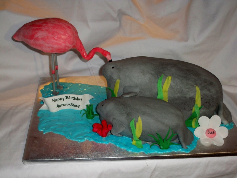 Flamingo kissing a Manatee :)